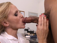 Teacher with heavy tits Julia Ann gags on student's funereal cock concerning class